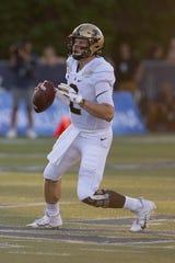 Aug 30, 2019; Reno, NV, USA; Purdue quarterback Elijah Sindelar (2) looks to pass during the first quarter against the Nevada Wolf Pack at Mackay Stadium. Mandatory Credit: David Calvert-USA TODAY Sports