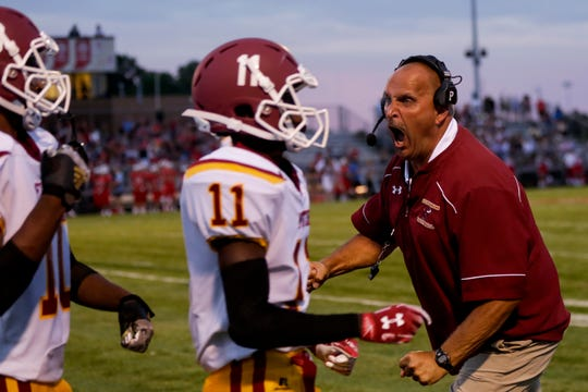 McCutcheon head coach Ken Frauhiger reacts after the Mavericks recovered a muffed punt against West Lafayette.