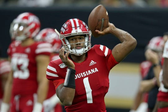 Louisiana Ragin Cajuns quarterback Levi Lewis (1) warms up before their NCAA football game against the Mississippi State Bulldogs in New Orleans, Saturday, Aug. 31, 2019. (AP Photo/Chuck Cook)