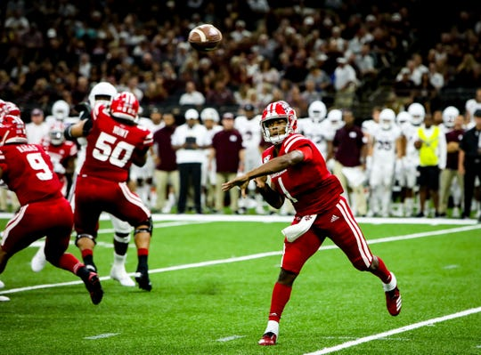UL QB Levi Lewis finds an open receiver in the football game between UL and Mississippi State University at the Superdome in New Orleans, Louisiana on August 31, 2019.