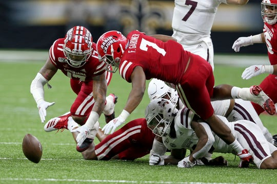 UL linebackers Chauncey Manac (17) and Ferrod Gardner (7) dive for the football after Michael Jacquet stripped it from Mississippi State quarterback Tommy Stevens during Saturday's game at the Mercedes-Benz Superdome in New Orleans.