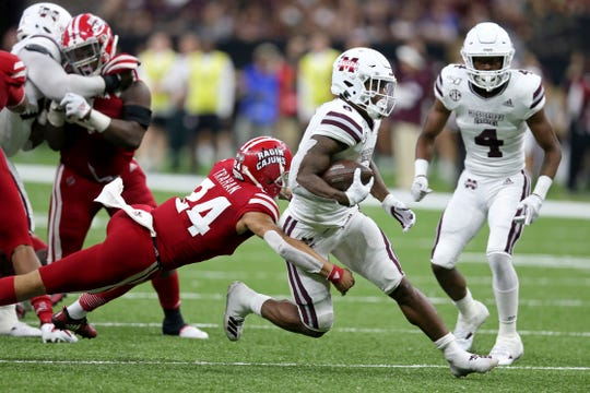 Mississippi State running back Kylin Hill (8) is tackled by Louisiana defensive back Bralen Trahan (24) in the second quarter of an NCAA college football game in New Orleans, Saturday, Aug. 31, 2019. (AP Photo/Chuck Cook)