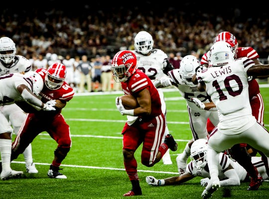 UL RB Trey Ragas finds an opening on his way to the end zone in the football game between UL and Mississippi State University at the Superdome in New Orleans, Louisiana on August 31, 2019.