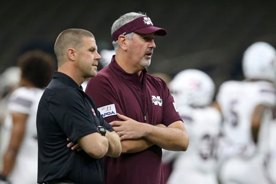 UL coach Billy Napier, left, and Mississippi State coach Joe Moorhead, who was fired Friday, talk before their Aug. 31 game in New Orleans.