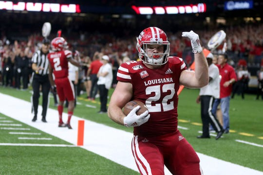 Louisiana tight end Nick Ralston (22) celebrates his touchdown in the second quarter of an NCAA football game against the Mississippi State in New Orleans, Saturday, Aug. 31, 2019. (AP Photo/Chuck Cook)