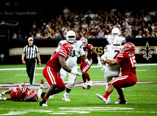 UL defensive lineman Bennie Higgins brings down Mississippi State quarterback Tommy Stevens earlier this season at the Superdome in New Orleans.