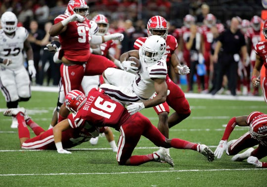 Mississippi State Bulldogs running back Nick Gibson (21) is tackled by Louisiana Ragin Cajuns defensive back Percy Butler (16) during the first half at the Mercedes-Benz Stadium.