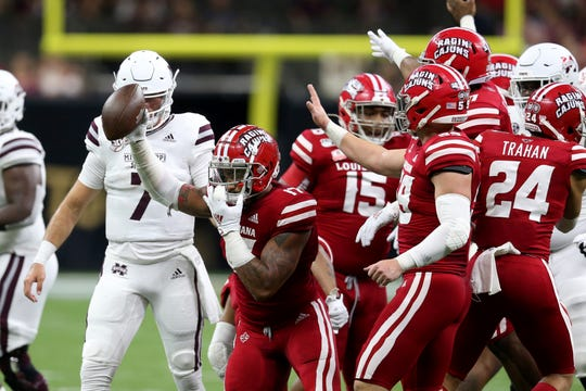 Louisiana linebacker Chauncey Manac (17) celebrates after recovering a fumble by Mississippi State quarterback Tommy Stevens (7) in the first half of an NCAA college football game in New Orleans, Saturday, Aug. 31, 2019.
