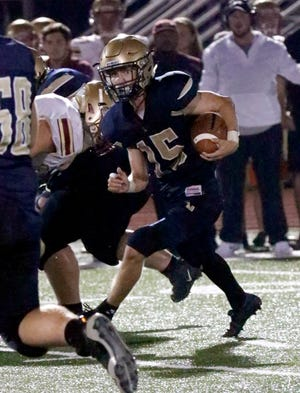 Lancaster senior Max Hamilton carries the ball during the Golden Gales' first game of the season against Watterson. After a week off, Lancaster will host Hilliard Darby at 7 p.m. Friday at Fulton Field.
