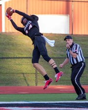 Pinckney's Caleb Wardlow makes a leaping catch that was originally ruled a touchdown before it was determined he was out of bounds in a 34-6 victory over Tecumseh on Friday, Aug. 30, 2019.