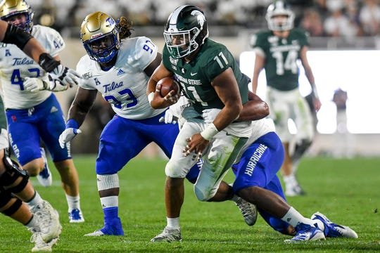 Michigan State's Connor Heyward runs for a gain during the third quarter on Friday, August 30, 2019, at Spartan Stadium in East Lansing.