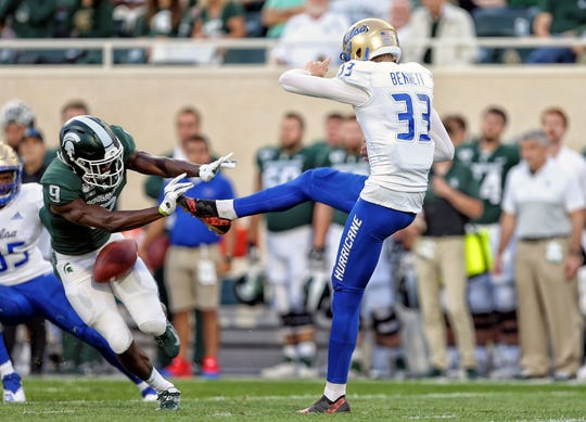 Aug 30, 2019; East Lansing, MI, USA; Michigan State Spartans safety Dominique Long (9) blocks a punt by Tulsa Golden Hurricane punter Thomas Bennett (33) during the first half of a game at Spartan Stadium. Mandatory Credit: Mike Carter-USA TODAY Sports