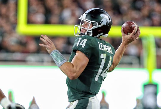 Aug 30, 2019; East Lansing, MI, USA; Michigan State Spartans quarterback Brian Lewerke (14) looks to throw the ball during the first half of a game against the Tulsa Golden Hurricane at Spartan Stadium. Mandatory Credit: Mike Carter-USA TODAY Sports