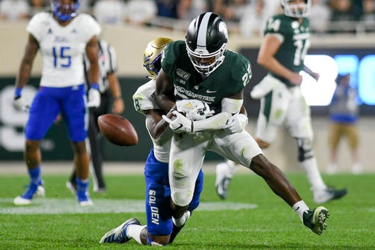Michigan State's Darrell Stewart Jr. drops a pass as Tulsa Brandon Johnson defends during the fourth quarter on Friday, August 30, 2019, at Spartan Stadium in East Lansing.