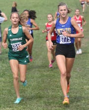 Ontario freshman Brienne Trumpower took Ashland Cross Country Invite meet champion honors in the Division II/III race with a time of 19:19.1 for her first career victory and leading the Lady Warriors to the team championship.