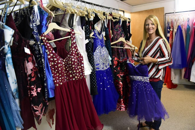 Amber Echelberry shows off a few of the selections in her new formal dress shop, Formal Exchange.