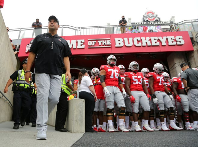 Ryan Day waits to take the field with his Ohio State Buckeyes before last year's opener with Florida Atlantic.
