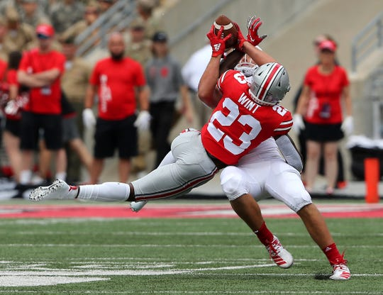 Ohio State safety Jahsen Wint battles for a pass intended for FAU wide receiver Tavaris Harrison.