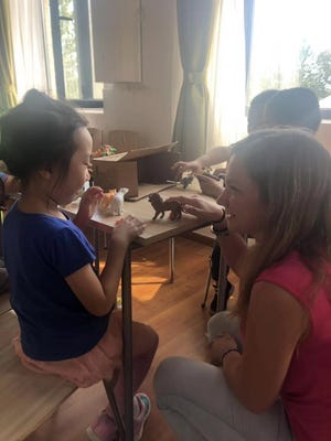 Alexis Shambaugh interacts with some of her students in China.