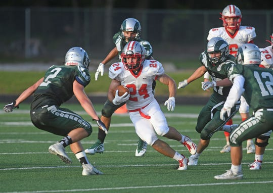 Shelby's Owen Fisher had a huge opener, rushing for 215 yards and four touchdowns.