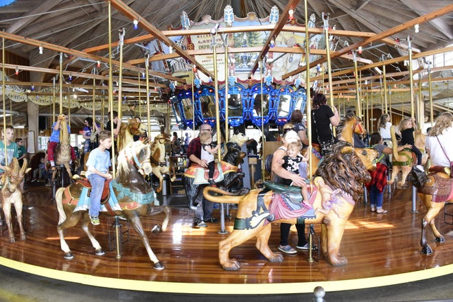 Children ride the carousel during the 28th anniversary of the Richland Carrousel Park.