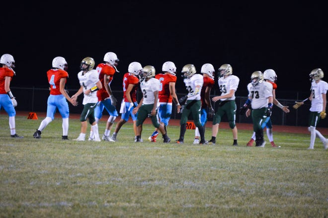 The Ridgedale and Ridgemont football teams shake hands following this year's season opener. If the Rockets are accepted in November, the two schools will be in the Northwest Central Conference together starting in 2021-22.
