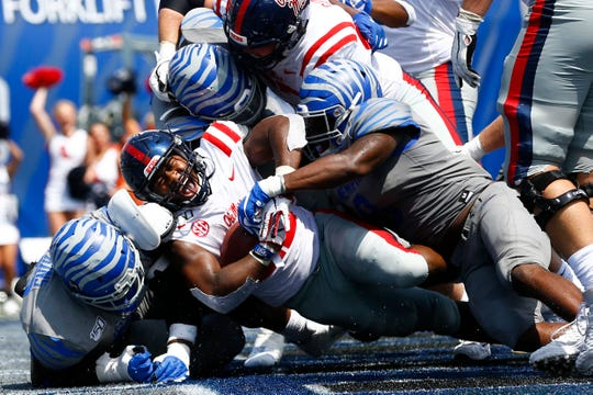 Ole Miss running back Scottie Phillips dives in for a touchdown against the Memphis Tigers at the Liberty Bowl Memorial Stadium on Saturday, August 31, 2019.
