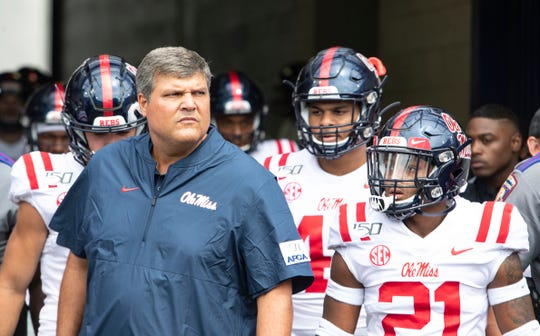 Ole Miss head coach Matt Luke prepares his players to run out on the field before their game against Memphis at the Liberty Bowl Memorial Stadium on Aug. 31, 2019.