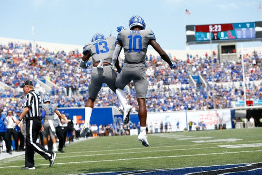 Memphis Tigers wide receiver Damonte Coxie, right, and Kedarian Jones celebrate a touchdown against Ole Miss at the Liberty Bowl Memorial Stadium on Saturday, August 31, 2019.
