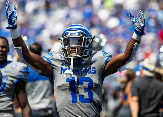 Memphis wide receiver Kedarian Jones (13) celebrates after the Tigers defeat Ole Miss 15-10 at the Liberty Bowl Memorial Stadium on Saturday, August 31, 2019.