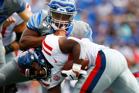 Memphis Tigers defender JJ Russell tackles Ole Miss running back Scottie Phillips at the Liberty Bowl Memorial Stadium on Saturday, August 31, 2019.