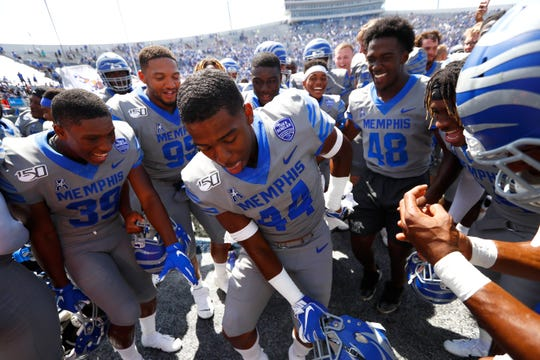 Memphis Tigers defensive back Kendell Johnson is surrounded by teammates as they celebrate their 15-10 win over Ole Miss at the Liberty Bowl Memorial Stadium on Saturday, August 31, 2019.