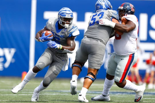 Memphis Tigers running back Patrick Taylor Jr. carries the ball against Ole Miss at the Liberty Bowl Memorial Stadium on Saturday, August 31, 2019.
