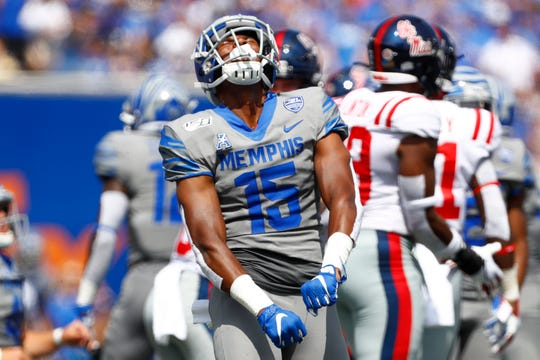 Memphis Tigers defensive back Quindell Johnson celebrates a tackle on a punt return against Ole Miss at the Liberty Bowl Memorial Stadium on Saturday, August 31, 2019.
