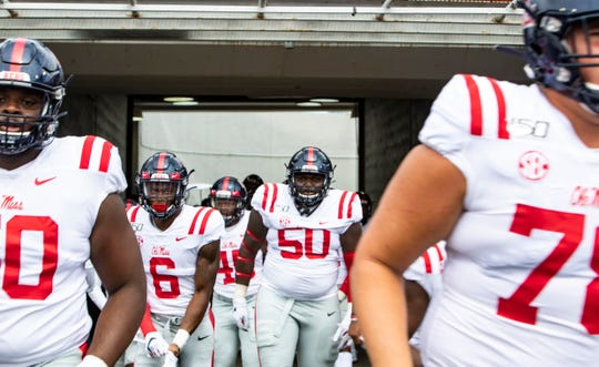 Ole Miss players run out onto the field before their game against Memphis. The Rebels play Arkansas this week.