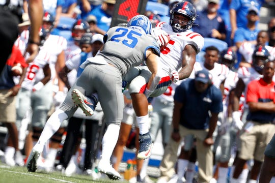 Memphis Tigers linebacker Austin Hall tackles Ole Miss wide receiver Dannis Jackson at the Liberty Bowl Memorial Stadium on Saturday, August 31, 2019.