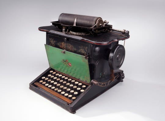 "Christopher Sholes' typewriter, the one that brought us the QWERTY keyboard, is part of ""Magnificent Machines of Milwaukee,"" showing at the Grohmann Museum."