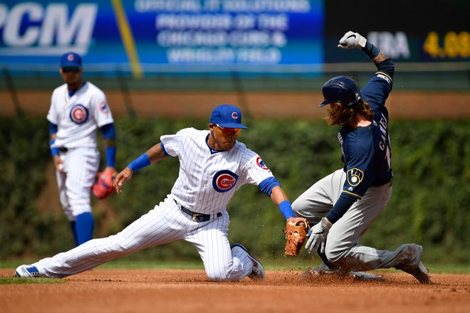 Brewers leftfielder Ben Gamel slides into second base for a double in the first inning against Cubs second baseman Addison Russell at Wrigley Field.