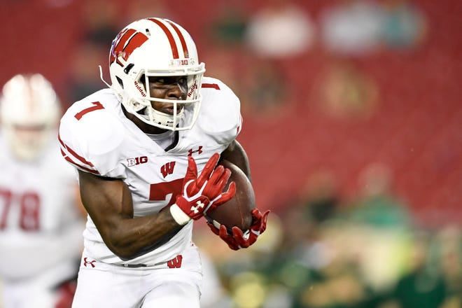 Badgers running back Bradrick Shaw runs for a touchdown midway through the fourth quarter.