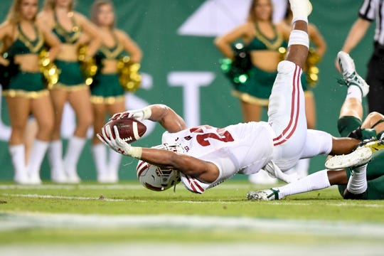 Badgers running back Jonathan Taylor stretches across the goal line for a 12-yard touchdown reception with two seconds remaining in the first half.