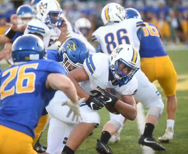 Mountain Home's Brock Bogy carries the ball against Sheridan on Friday night.