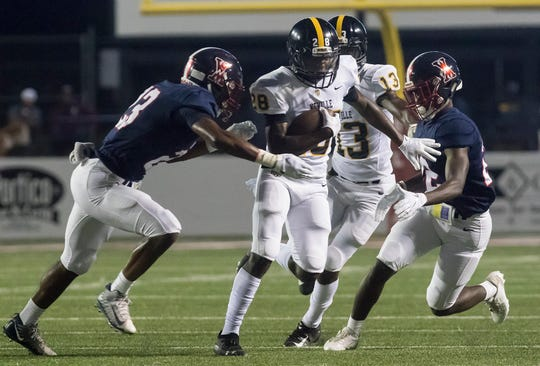 Neville running back A.J. Allen (28) carries the ball against West Monroe at Bayou Jamb. The Tigers defeated the Rebels 17-13 in the jamboree on Aug. 30 at ULM's JPS Field at Malone Stadium.