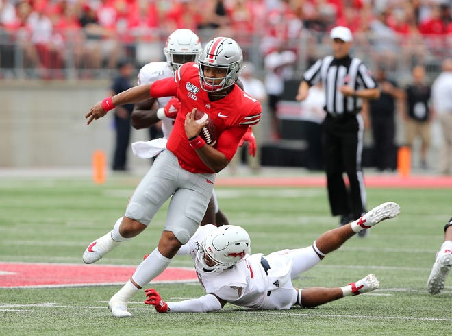 Aug 31, 2019; Columbus, OH, USA; Ohio State Buckeyes quarterback Justin Fields (1) runs a first quarter touchdown against the Florida Atlantic Owls at Ohio Stadium. Mandatory Credit: Joe Maiorana-USA TODAY Sports