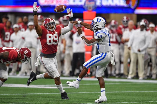 Aug 31, 2019; Atlanta, GA, USA; Duke Blue Devils quarterback Quentin Harris (18) throws over Alabama Crimson Tide defensive lineman LaBryan Ray (89) during the first quarter at Mercedes-Benz Stadium. Mandatory Credit: Dale Zanine-USA TODAY Sports