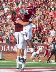 Troy's Reggie Todd celebrates his touchdown during the first quarter.