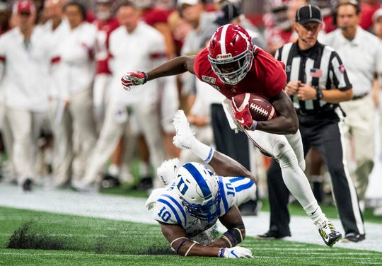 Alabama wide receiver Jerry Jeudy (4) eludes Duke safety Marquis Waters (10) and stays in bounds in the Chick-fil-A Kickoff Game at Mercedes Benz Stadium in Atlanta, Ga., on Saturday August 31, 2019.