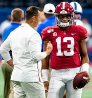 Alabama offensive coordinator Steve Sarkisian talks with Alabama quarterback Tua Tagovailoa (13) during warm ups before the Chick-fil-A Kickoff Game at Mercedes Benz Stadium in Atlanta, Ga., on Saturday August 31, 2019.