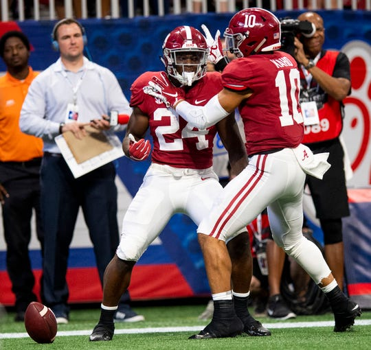 Alabama running back Brian Robinson, Jr., (24) and Alee Kaho (10) celebrate Robinson's touchdown against Duke in the Chick-fil-A Kickoff Game at Mercedes Benz Stadium in Atlanta, Ga., on Saturday August 31, 2019.
