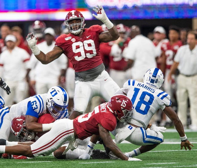Alabama defensive lineman Raekwon Davis (99) and defensive back Xavier McKinney (15) pressure Duke quarterback Quentin Harris (18) in the Chick-fil-A Kickoff Game at Mercedes Benz Stadium in Atlanta, Ga., on Saturday August 31, 2019.