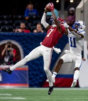 Alabama defensive back Trevon Diggs (7) intercepts a pass intended for Duke wide receiver Scott Bracey (11) in the Chick-fil-A Kickoff Game at Mercedes Benz Stadium in Atlanta, Ga., on Saturday August 31, 2019.